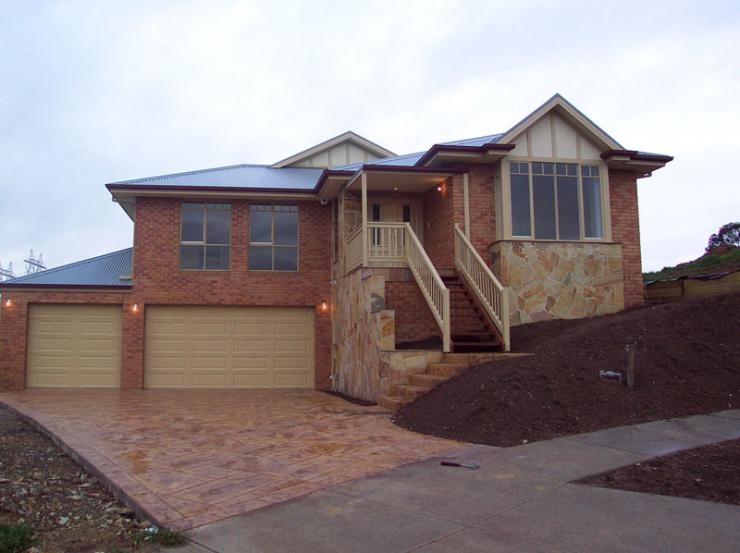 Building on a slope joe 39 s construction home design for Building a house on a slope